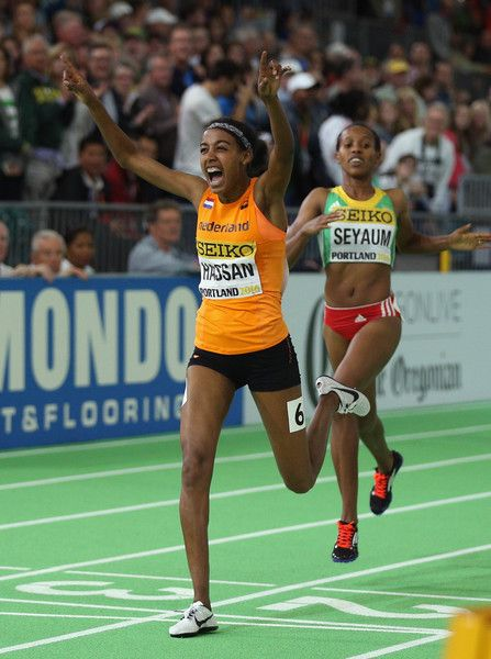 Sifan Hassan of the Netherlands crosses the line to win gold in the Women's 1500 Metres Final during day three of the IAAF World Indoor Championships at Oregon Convention Center on March 19, 2016 in Portland, Oregon.