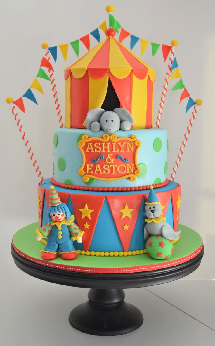 Circus Birthday Cake - This circus cake was for a brother and sister turning 3 and 4 years old!!  The cakes are covered in marshmallow fondant.  Tylose powder was added for the tent top and characters.  Major inspiration was taken from CC user heatherscakes' circus cake, which was absolutely adorable!!