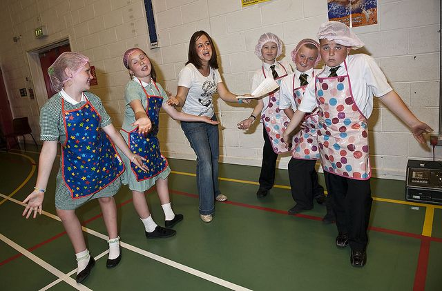 Pint sized dinner ladies dished up a drama to show friends and relatives why they should make mealtimes a balancing act.    Nine and ten year olds at St Laurence's primary in Knowsley put on a play to promote tasty school dinners that include all the r this is awsome
