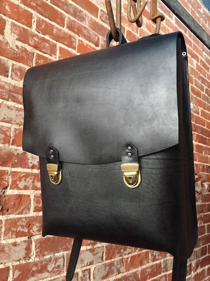 A personal favourite from my Etsy shop https://www.etsy.com/au/listing/286417773/the-old-school-backpack-black-leather
