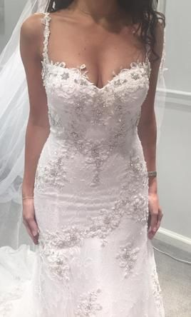 Unique Pnina Tornai buy this dress for a fraction of the salon price on PreOwnedWeddingDresses