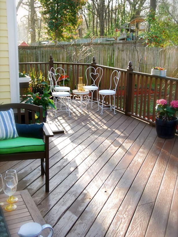Traditional and Comfortable Decks for Everyday Use: Extra-large decks can enhance any backyard, especially when stretched around the side of a house. Designer John Gidding didn't want to waste space, so he created a small private nook with a cafe table and four chairs to serve as an intimate conversational spot. The detail in the deck railing adds that extra spark of sophistication to a seemingly simple deck. From DIYnetwork.com
