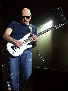 """Joe Satriani:  Often lumped in with the """"plays like they're getting paid by the note"""" guitarists, Joe Satriani has a range and creative ability that sets him apart from the others. I like the fact that he's as prolific a writer as he is because that means it will be a long time before I begin to get sick of him."""