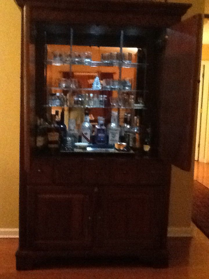 turned our unused tv armoir into a barliquor cabinet mirror mounted on back