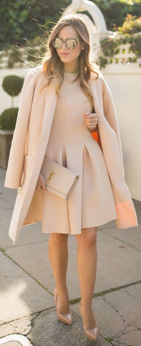 Julia Engel is wearing a nude outfit, the coat is from Michael Kors, dress from Chicwish, shoes from Christian Loboutin, clutch from Saint Laurent, sunglasses from Dolce & Gabbana