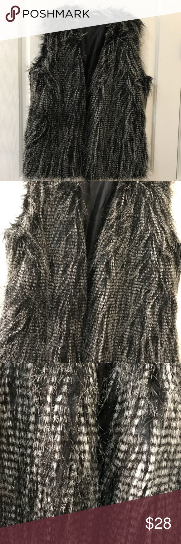 Belle Bird Faux Fur Black and Silver Vest Belle Bird Faux Fur Black and Silver  Gray Vest. Very pretty, great with jeans or black leggings. Dress it up or down. Size XL NWOT Bell Bird Jackets & Coats Vests