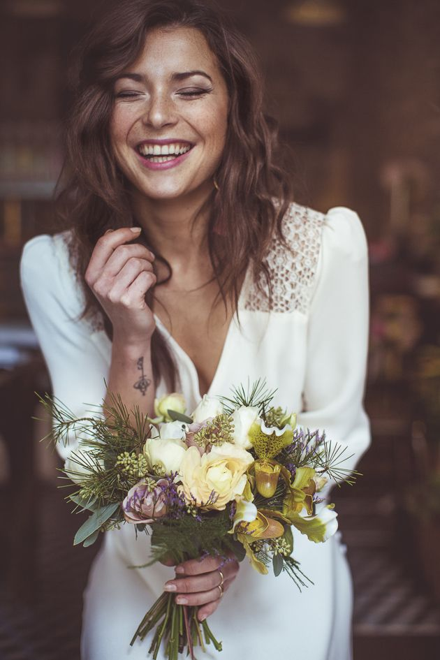 gorgeous boho bride laughing