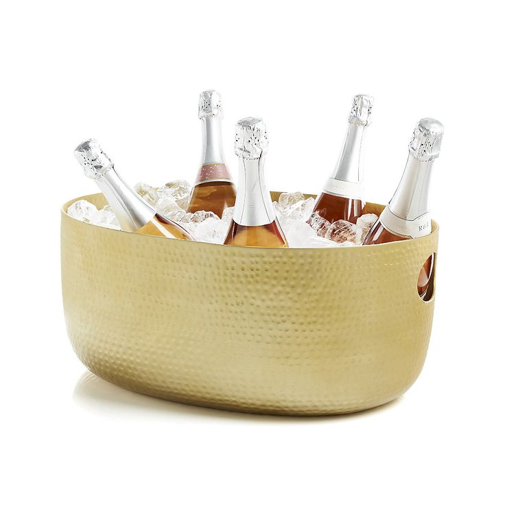 Shop Bash Gold Beverage Tub. Hand-hammered aluminum beverage tubs with a warm, gold finish puts the big chill on a party's worth of wines and beers.