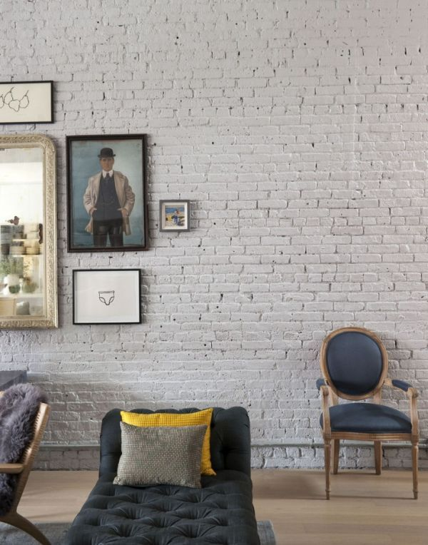 Brooklyn Family Loft In A Former Factory. I love the display of frames on the wall and the mix of chairs and sofas. This has a vintage modern look to it.
