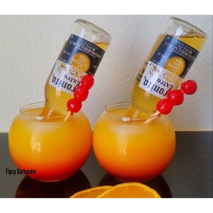 Corona Sunset Cocktail - For more delicious recipes and drinks, visit us here: www.tipsybartender.com