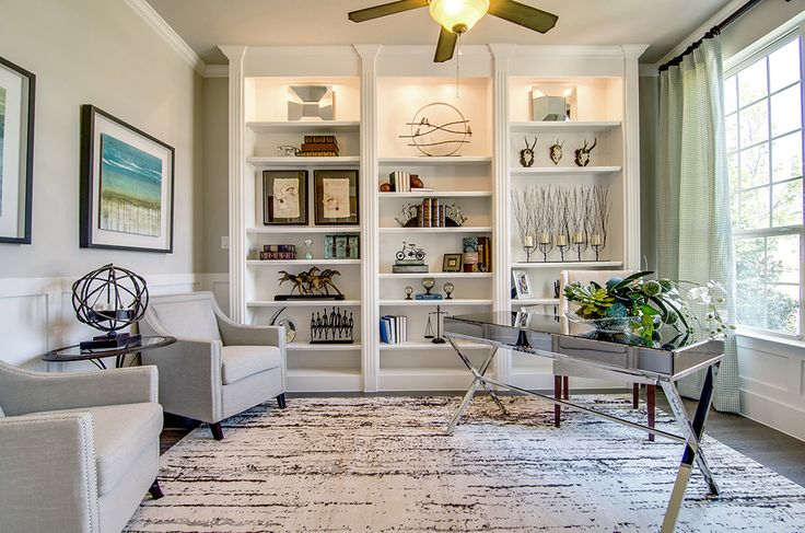 Gehan Homes Study - White Bookshelves, White Cabinetry, Cool Area Rug, Glass Desk, Green Patterned Curtains, Grey Lounge Chairs, Underlit Bookshelves, Lighted Shelving, Underlit Cabinetry - Dallas, Texas   Stonebryck Manor - Oxford #gehanhomes