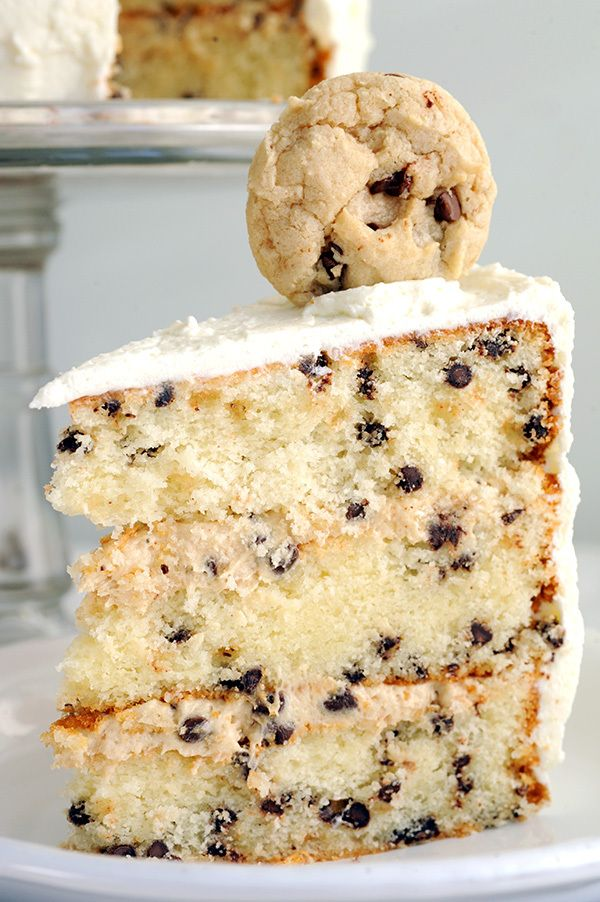 A Chocolate Chip Cookies and Milk Cake. Holy. Cow. This vanilla cake is speckled with chocolate chips, layered with cookie dough frosting, wrapped in milk icing and topped with chocolate chip cookies.