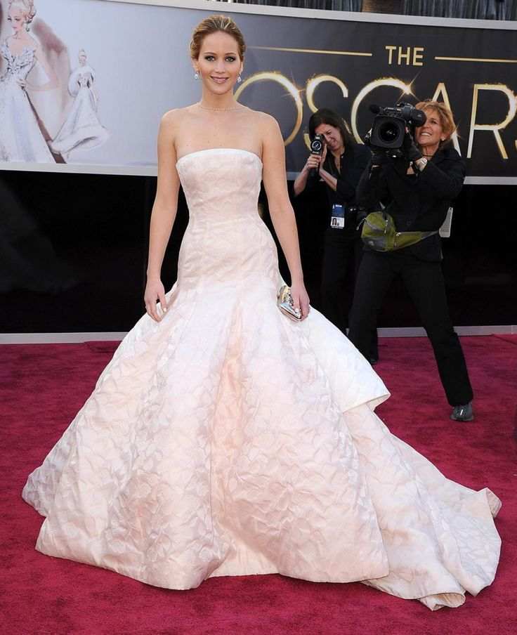 "Jennifer Lawrence wore a voluminous shell pink Dior gown at the 2013 Academy Awards -- which she later tripped on when she won for ""Best Actress"" in ""American Hustle."""