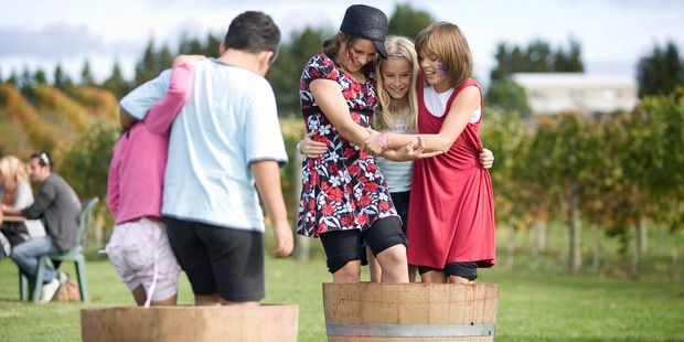 Stomping grapes at Soljans' Berba Harvest Festival continues to attract the crowds each Easter. Kumeu. Photo / NZME. Read more on Dalmatians Croatians in auckland in NZ Herald 28 March 2015. #Kumeu #Winery #Soljans