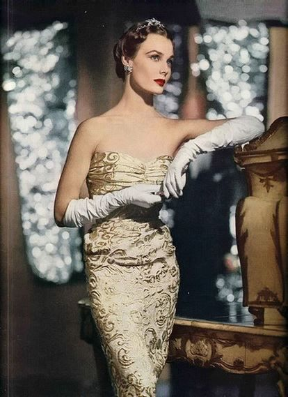 Lilian Marcusson in strapless gold brocade evening gown 1950 photo by Gordon Parks