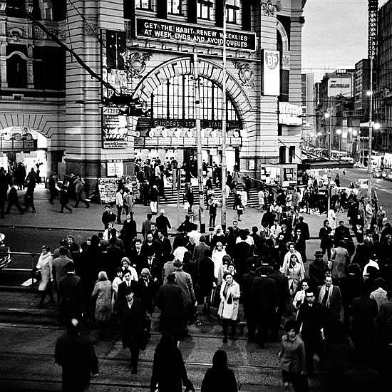 Under the Clocks, Flinders Street Station Melbourne Victoria Australia Angus O'Callaghan (1922-.) Australia.  Angus dedicated three years in the late 60s and early 70s to documenting a Melbourne that no longer exists. These medium format photographs display a love for a home as strengthened by a long absence, a passionate mind and a keen sense of belonging. Angus's photographs were initially published in 1956 and he split his time between photography and teaching until his retirement in…