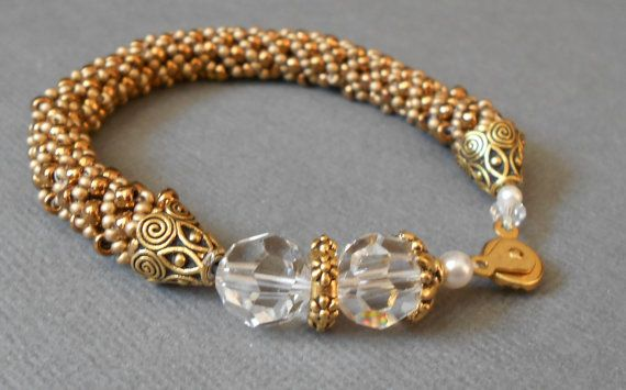 NICE WAY TO END KUMI BEADED IF IT'S TOO SHORT...........................gold beaded bracelet in a russian spiral