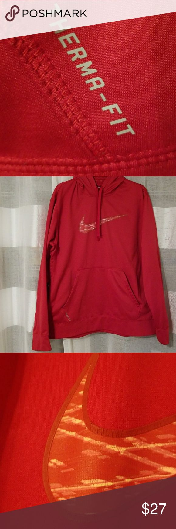 Red Nike Therma-Fit Hoodie Deep Red Therma-Fit Fleece Lined Hoodie. Gently worn in smoke free home. Fabric is in excellent condition with the exception of the bottom band in the front. (See photos) Was ACCIDENTALLY WORN (men?!?) during an impromptu paint project & has some tiny white paint splatters that were gone over with a red dye pen. Hardly noticeable when worn unless you are focused on that one spot. The entire rest of the hoodie is in absolutely great shape! Nike Shirts Sweatshirts…