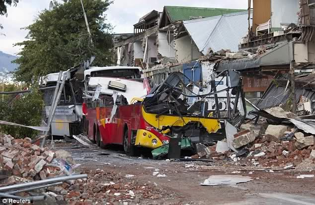 Colombo Street, scene of many fatalities, with buses crushed and buildings falling into the street