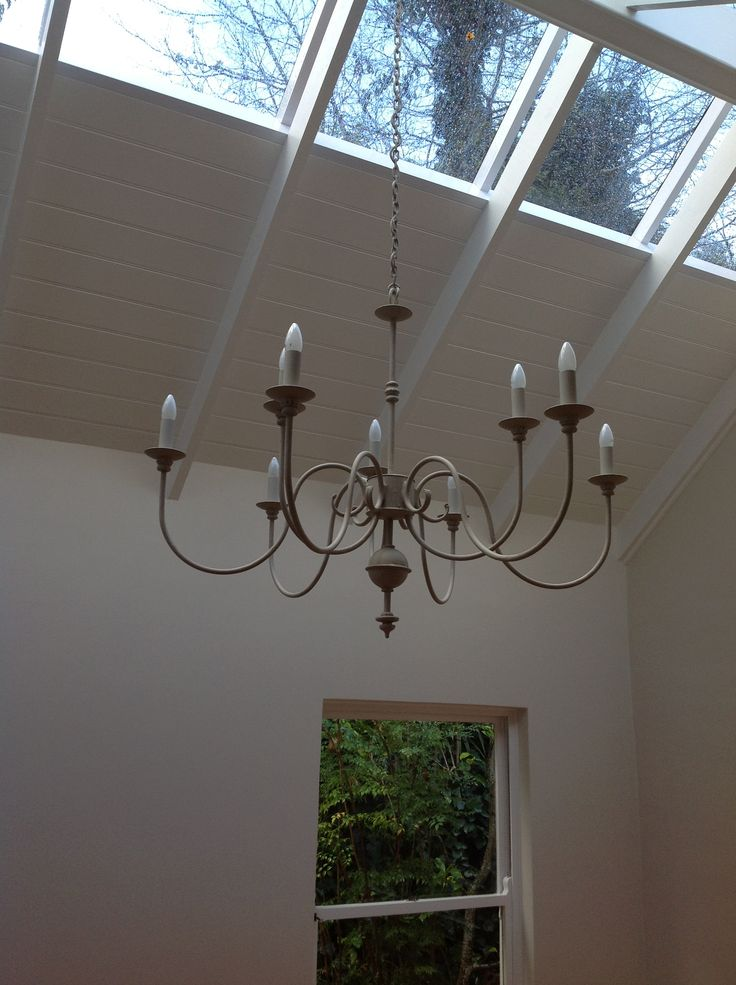 The smaller Bastille 9 arm chandelier in our Linen paint finish..