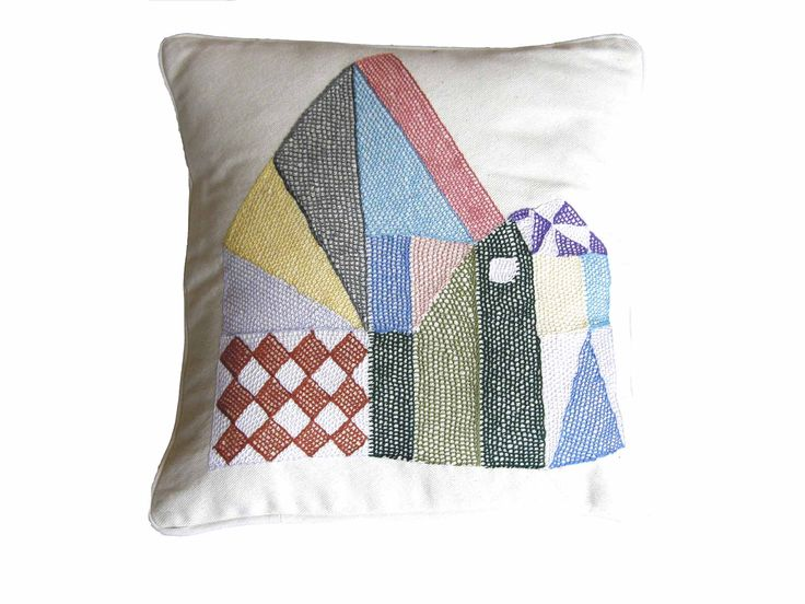 with Mum's (Finland) TALO/ House-cushion. Embroidered in the hands of South African ladies. Image by Susanna Vento, product design by Mum's.