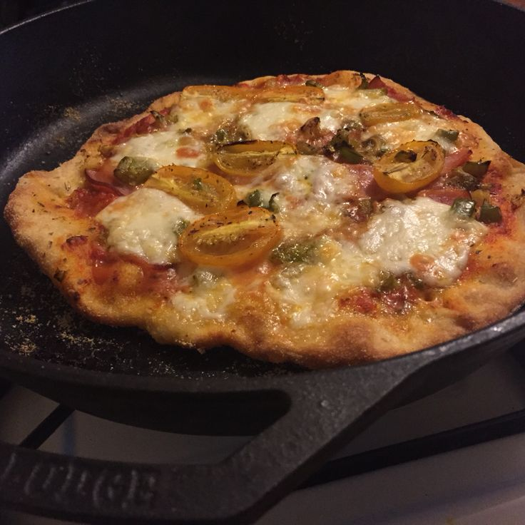 Make a #rustic #pizza // Heat oven to 450-475 & place cast-iron skillet in oven. I split doughball in half to make 2 small pies. Cover plastic cutting board with  #semolina . Stretch dough & cover with EVOO then sauce and toppings (I used roasted onion, peppers, tomato and garlic, Canadian bacon, and fresh mozz). Remove hot pan from oven, shake the board to release pie to pan & bake 12-15 min or until cheese is brown. #pizzarules #castironpizza #foodie #foodporn #recipe #delicious