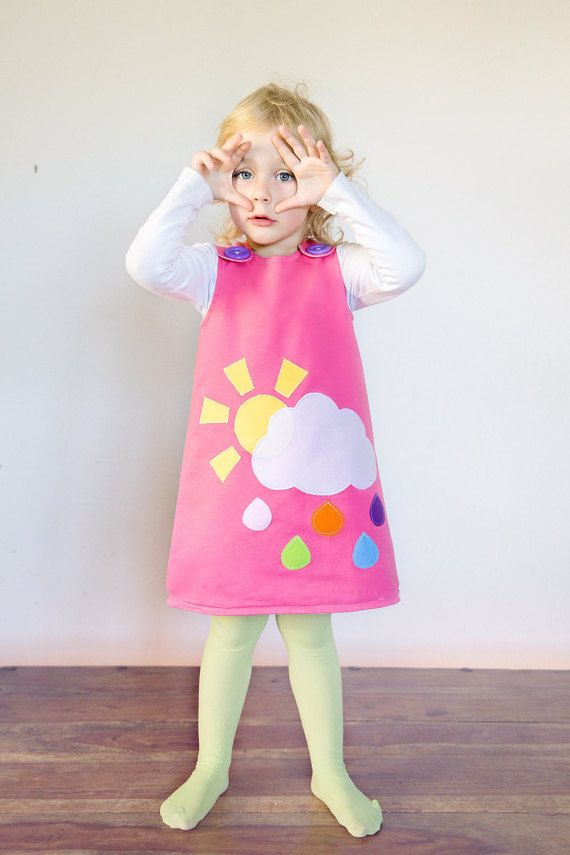 A beautiful winter dress with applique patterns. Sun, rain and a beautiful cloud.  Made from 100% soft cotton fabric, fully lined to hide any