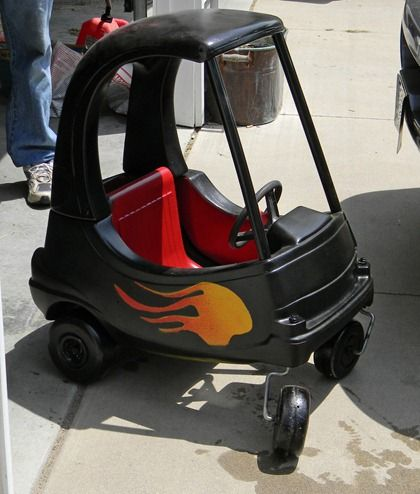 We lucked out and found an old Little Tykes car at a garage sale. My DH painted it up, DS did the flames. DGS loves it!