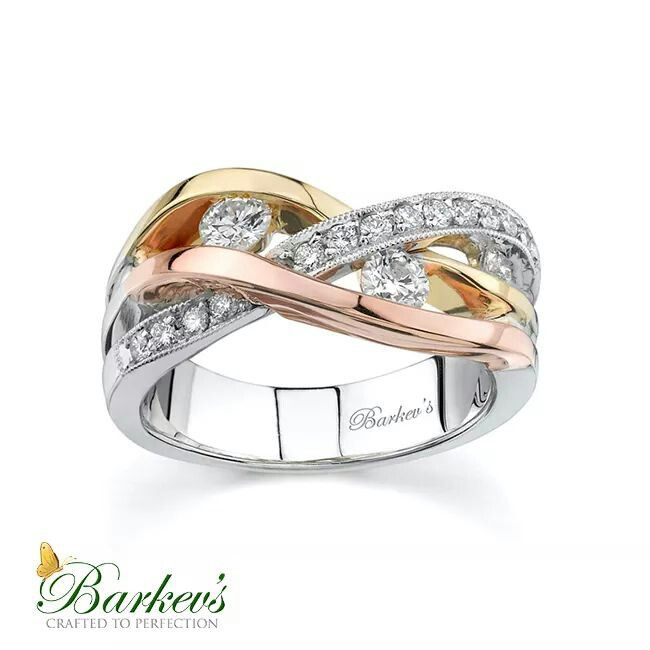 Amazing Unique modern styling gives this tri color gold diamond wedding band it us pizzazz The white gold shank sports accents bands of yellow and rose gold