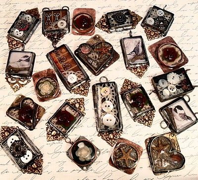 Bezels with antique items in them made by Tracy Bell.
