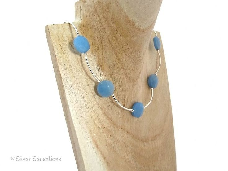 Blue Serpentine Jade Faceted Coins & Sterling Silver Curved Tubes Necklace from Silver Sensations. This beautiful handmade designer blue & silver necklace is an exclusive design. UK. @ProCrafterGuild