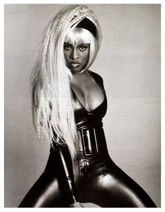 Lil' Kim is another female rapper that I grew up listening to. Her flow is slick and yes she's a bit raunchy but over all she's a legend! Suck on that Icki Garbage fans!