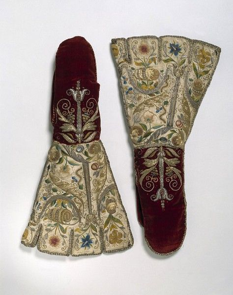 Mittens, 1600. Crimson velvet and white satin, embroidered with silver and silver-gilt thread, coloured silks, beads and spangles (sequins)