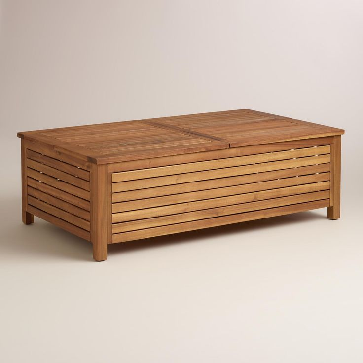 With a chunky, slatted profile, this multifunctional coffee table features four lift-off lids that reveal storage underneath and also double as serving trays. >> #WorldMarket Outdoor Entertaining & Decor