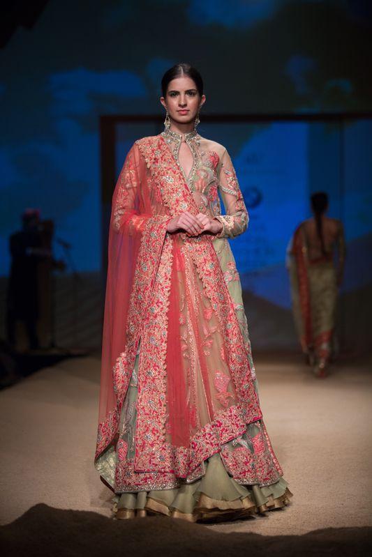 Ashima Leena layered olive green and pink lehnga. More here: http://www.indianweddingsite.com/bmw-india-bridal-fashion-week-ibfw-2014-ashima-leena/