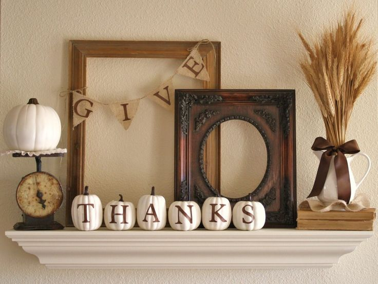"""Fall Mantel - """"...warm gratitude-theme mantel. Layered frames and a wheat arrangement add height and depth, while white touches guide the eye across the mantel. Stencils came in handy for the lettering on her burlap banner and painted pumpkins."""""""