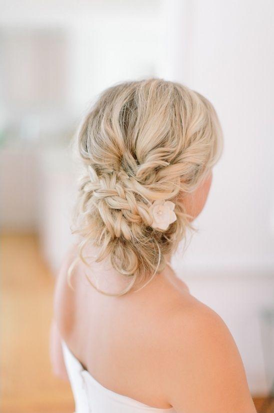 Beach Wedding Hairstyles beach bridal hairstyles low curly bun by studio marie pierre Beach Wedding Hair