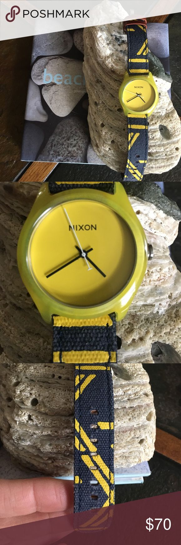 "Nixon women's surf watch Nixon women's watch with blue and yellow leather and canvas strap in excellent condition. No flaws. BWaterproof. Worn twice on vacation. Bought in Costa Rica. Don't have the box anymore. I do have other Nixon boxes if you really need a box. Battery in working order. Watch face 1.5""X1.5"". Nixon Accessories Watches"