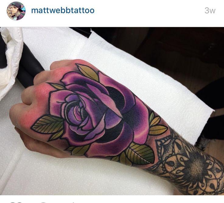Purple rose on hand tattoo