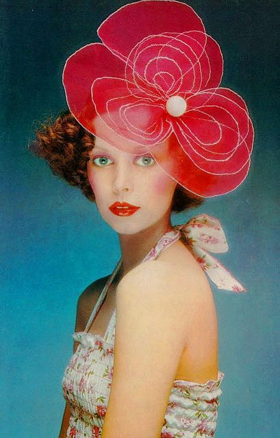 Model Mouche in a red floral headpiece and summer ruched halter blouse by Pablo and Delia. Photo by Barry Lategan, UK Vogue May 1972.
