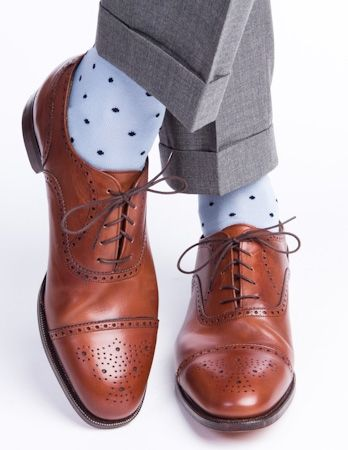 Dapper Classics has fun dress socks in every pattern and color combo. These sky blue with navy polka dot socks are only $20.