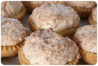 Hertzoggies Use smooth apricot jam or strawberry jam, with coconut meringue topping. Yummy