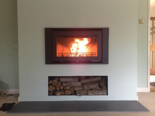 Inset fireplace, raised logstore and hearth.