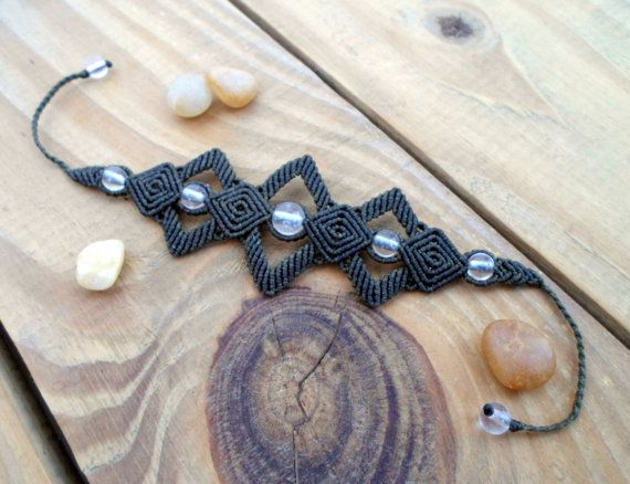 A beautiful macrame bracelet with Natural Crystal Quartz set in Khaki waxed thread which is waterproof and the bracelet maintain it's original shape for years. it's also very strong .