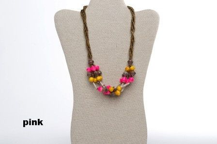 "Matooke Necklace - pink. This necklace is inspired by Ugandan traditional dish called ""Matooke"". The selection of colors allows playful and unique accessory to give some vibrant colors to a basic outfit. Made with strings with gold beads and recycled paper rolled beads. Available in two different color combinations that changes seasonaly."