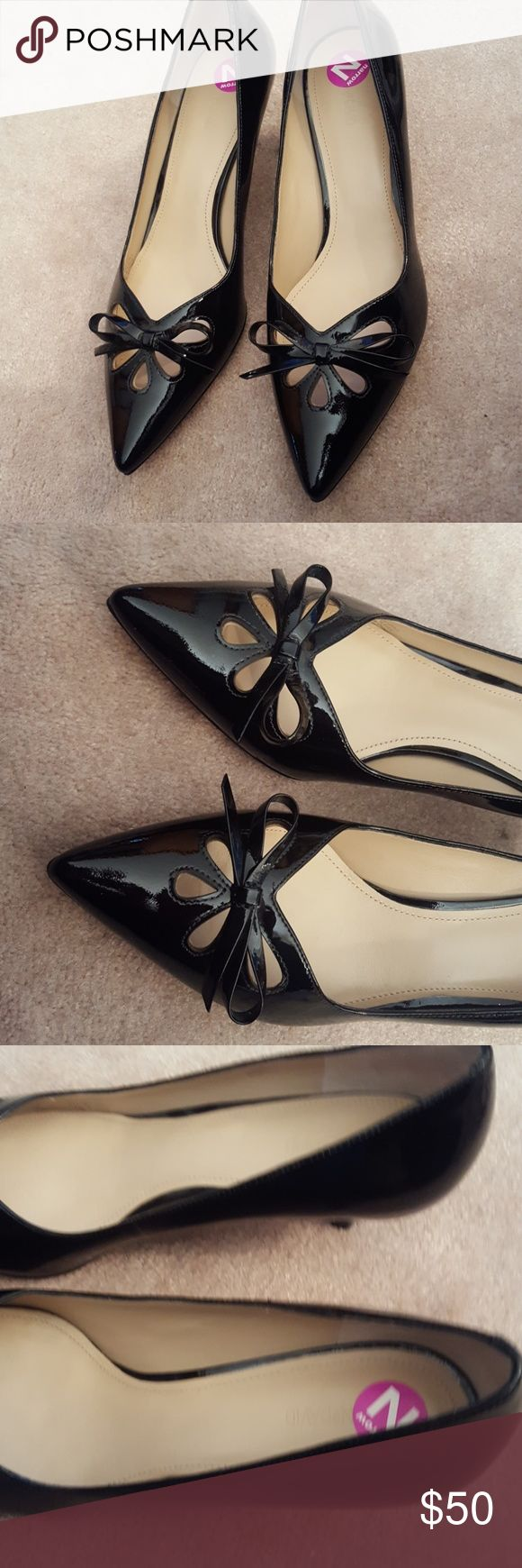 "Never Worn Joan & David  Paten Leather Size 9.5N Joan & David Dagardner Shoes Size 9.5 Narrow Black patent leather  2"" kitten heels Open flower design with bow  New with all tags but no original box Joan & David Shoes Heels"