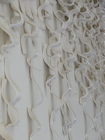 """WAVES; Residential Installation, Hallway (detail image 3).  96""""x 36"""".  The wave installation consists of hundreds of single strands of porcelain clay.  The final arrangement and design dependent upon the architectural space.  Katherine Dube 2000-2012."""