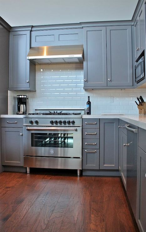 William Adams Design: Pretty gray kitchen cabinetry in L-shaped kitchen with polished nickel hardware. I also like the subway tile.