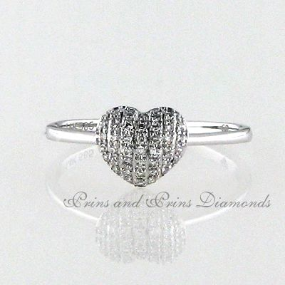 There are 43 = 0.12ct GH/VS – SI round cut diamonds multi pavé set in a 14k white gold heart shaped design