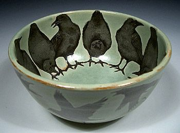A ring of crows line the interior of this slightly ominous bowl, waiting for food to arrive. Outside, a flock of crows circle, equally anxious for a meal.